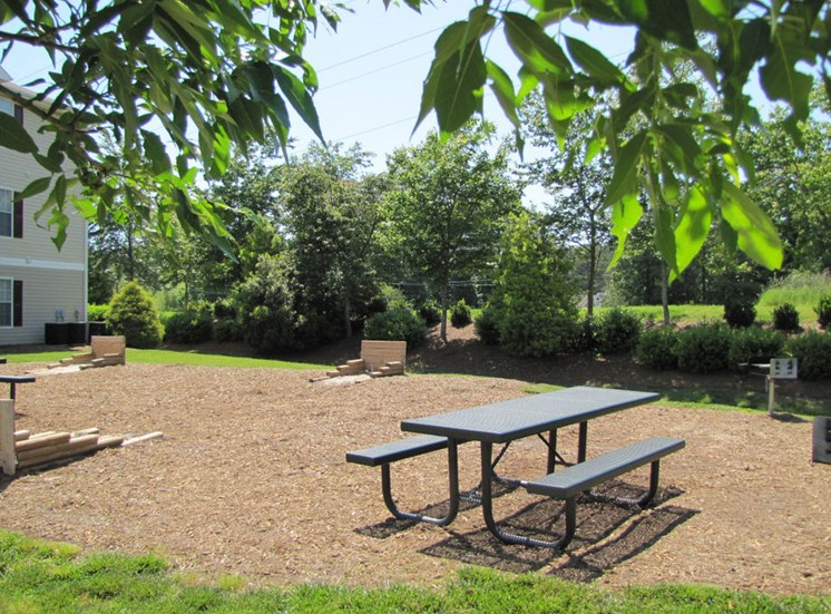 Picnic Area with Tables on Mulch at Foxridge Apartments, Durham, 27703