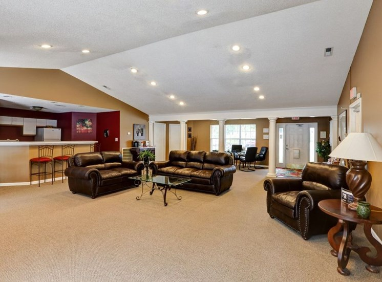 Clubhouse Seating Area with Leather Couch and Armchairs at Foxridge Apartments, Durham, NC