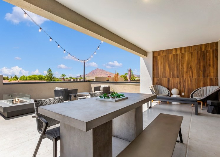 Rooftop Terrace Covered Picnic Area with Concrete Table and Benches with Fire Pit and Chairs in the Background
