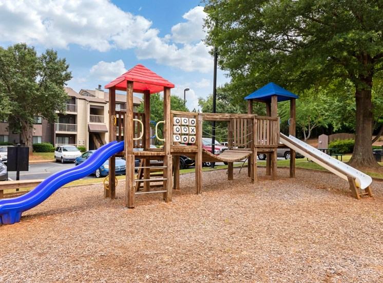 Wooden Playground with Blue Red and Yellow Accents on Mulch