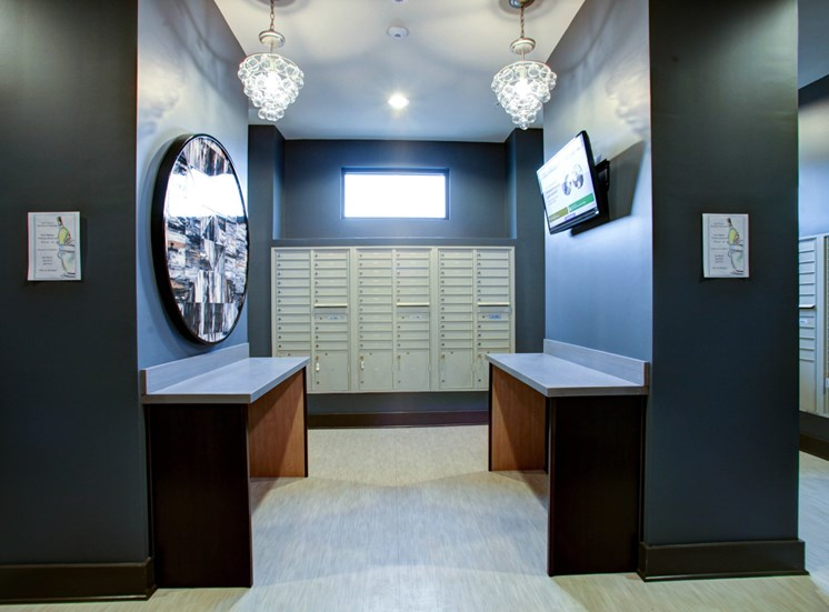 Indoor Mail Center With Tables Art and Mounted TV