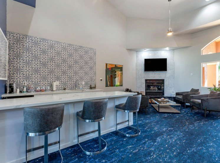 Clubhouse Seating Area with Blue and Grey  Scheme Coffee Bar and Mounted TV