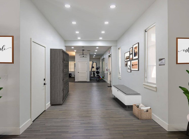 Hallway with Door, Windows and Hardwood Style Flooring , Virtually Placed Decorations, Shelf and Bench Leading to Fitness Center