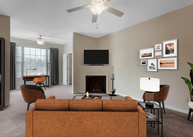 Virtual rendering of living room with fireplace, sofa, accent chairs, and television