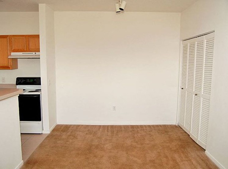 Dining Room with white walls and tan carpet