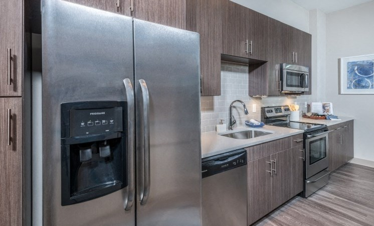 Kitchen with Wood Grain Cabinets and Stainless Steel Appliances