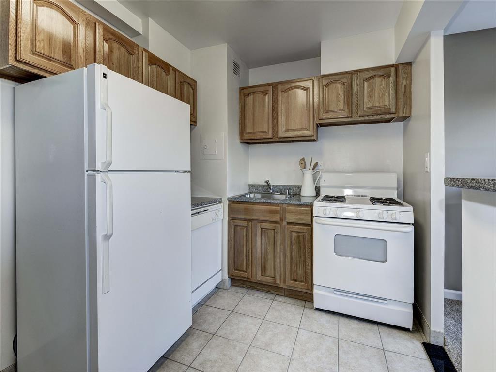 Kitchen with White Appliances at The Mark Apartments, Alexandria, VA