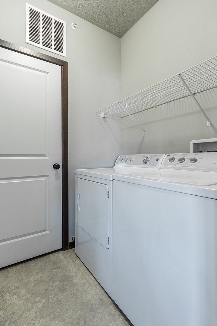 Full-sized washer and dryer in laundry room at the Villas at Wilderness Ridge in Lincoln Nebraska