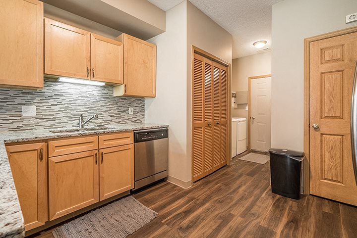 Upgraded unit with stainless-steel appliances and kitchen backsplash at Southwind Villas in La Vista, NE