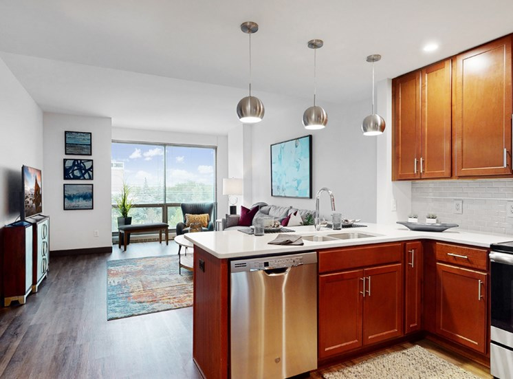 Midtown Crossing Apartments has floor-to-ceiling windows that fill this 1 bedroom apartment with bright natural light.
