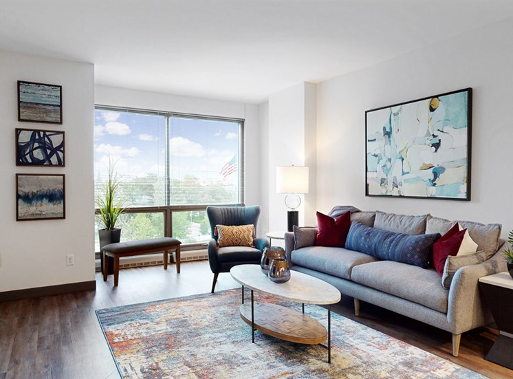 Enjoy the scenic views from the floor-to-ceiling windows in the living area of a 1 bedroom floor plan at Midtown Crossing Apartments Omaha
