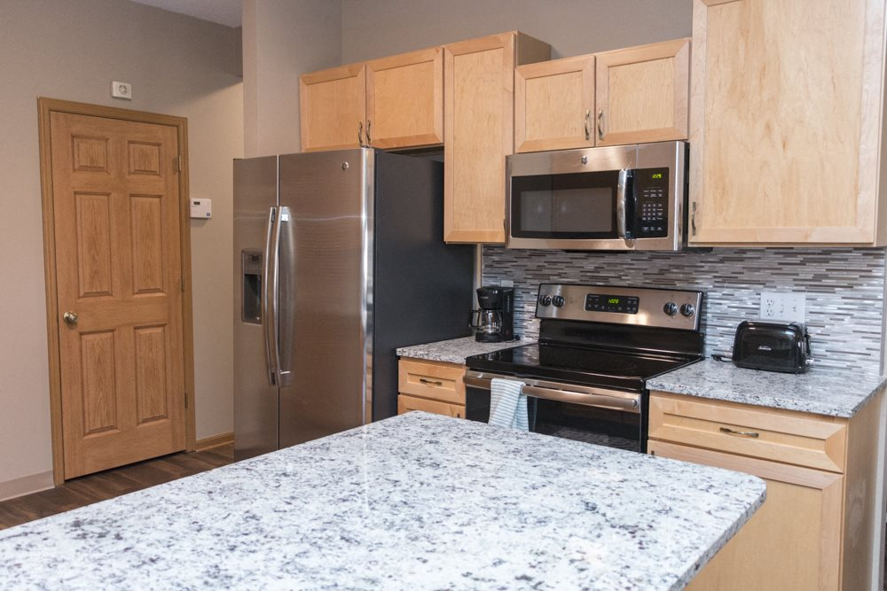 Granite countertops with kitchen backsplash in La Vista, NE
