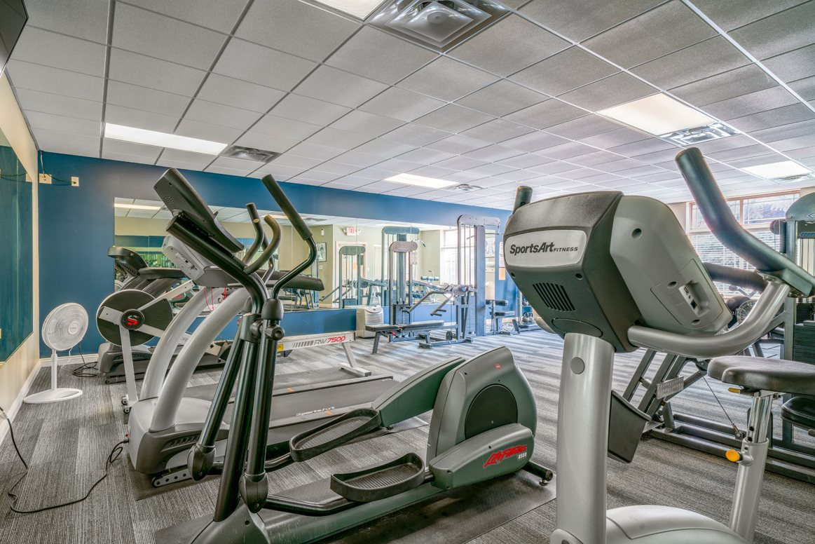 Modern fitness equipment and free weights available at Southwind Villas