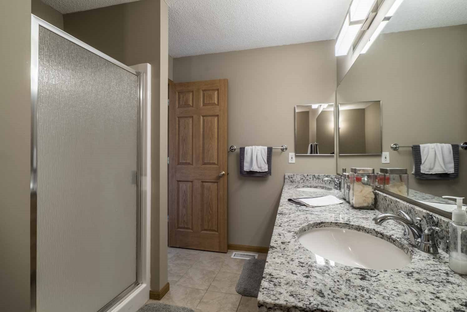 Master bath with shower and tub at at Southwind Villas in southwest Omaha in La Vista, NE, 68128