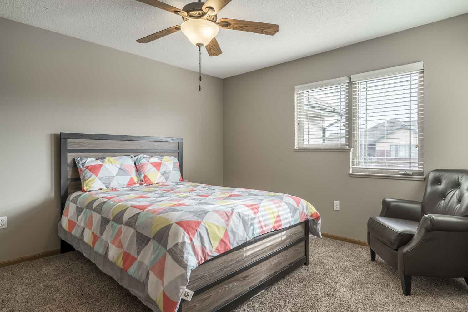 Second bedroom with ceiling fan at Southwind Villas in southwest Omaha in La Vista, NE, 68128