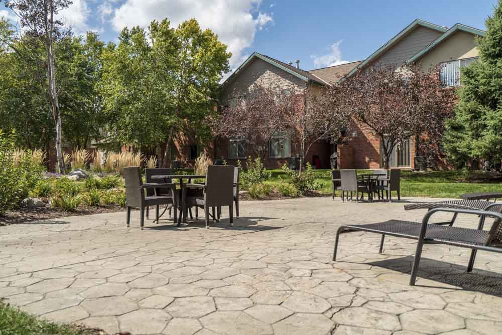 Outdoor patio with seating and courtyard  at Southwind Villas in southwest Omaha in La Vista, NE, 68128
