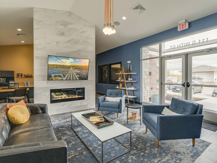 Television and seating area in the clubhouse at The Flats at Shadow Creek