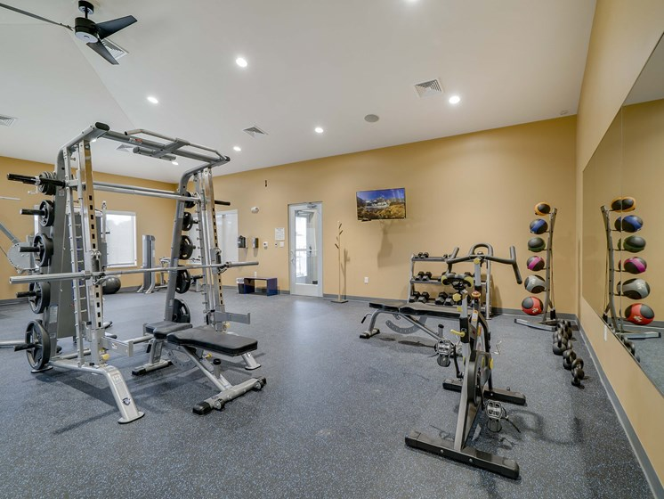 Weight lifting equipment in the fitness center at The Flats at Shadow Creek