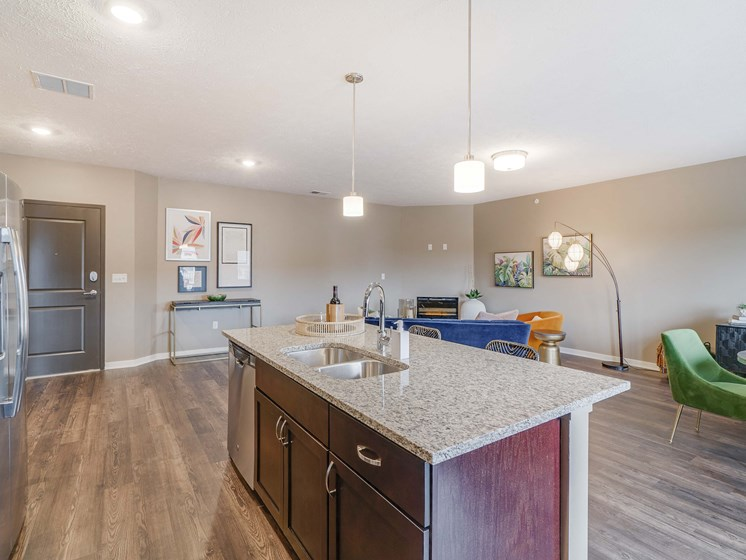 View of kitchen island and living room at The Flats at Shadow Creek