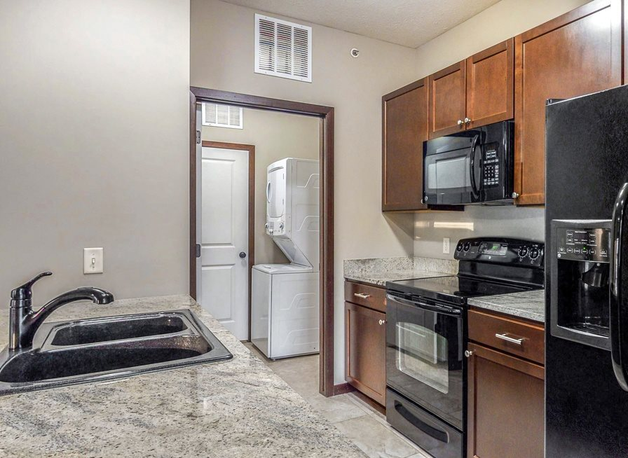 A separate laundry room is located right off the kitchen in the 2 bedroom Ash at The Villas at Wilderness Ridge in southwest Lincoln NE 68512