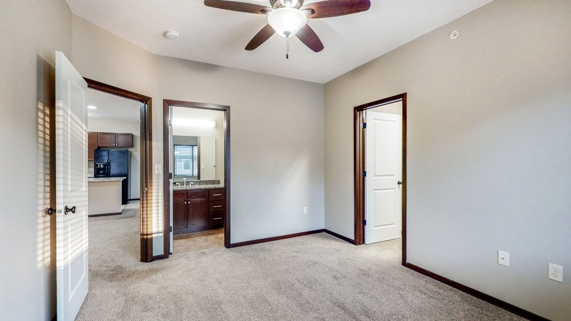 Spacious master bedroom in the Ash at The Villas at Wilderness Ridge luxury apartments in southwest Lincoln NE 68512