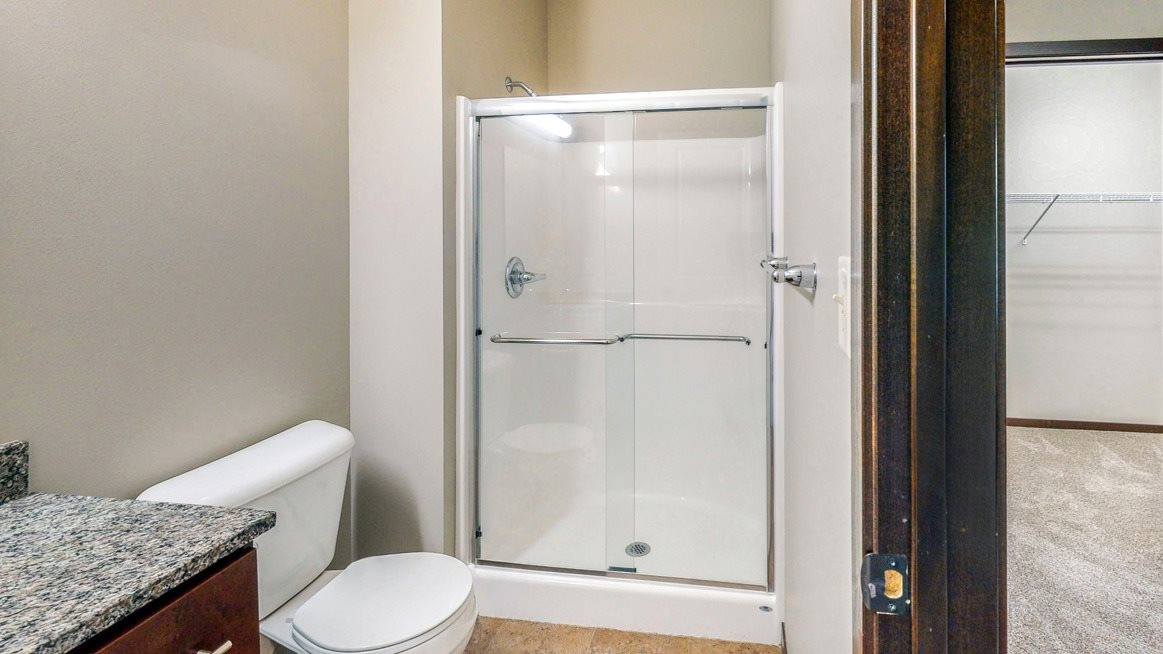 The master bath in the Ash features a shower with glass doors.