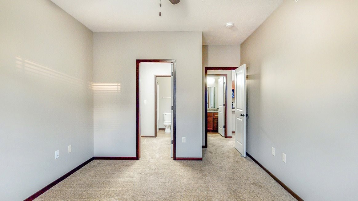 Spacious bedrooms with walk-in closets in the Ash at The Villas at Wilderness Ridge luxury apartments in southwest Lincoln NE 68512