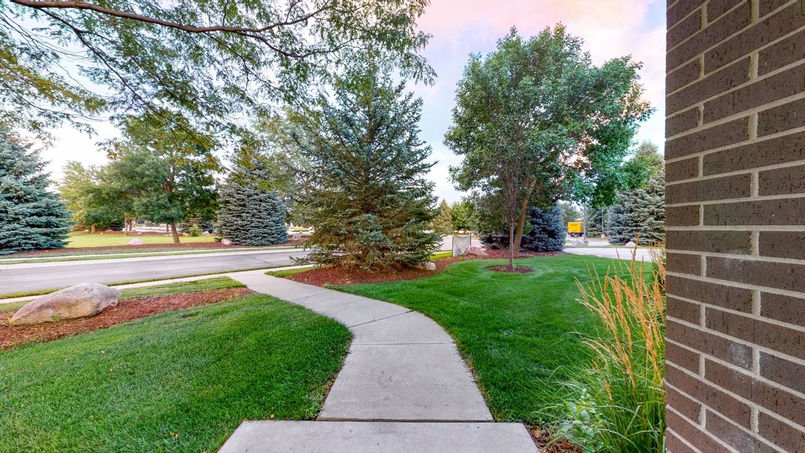 You'll love manicured landscape view from your private entrance of this two bedroom Cedar floor plan.