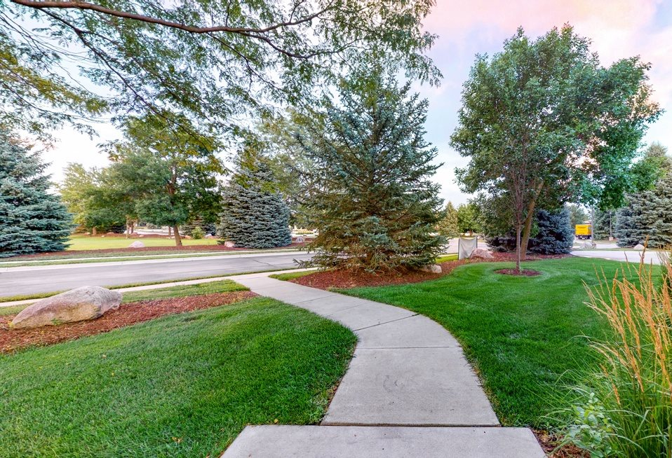 You'll love manicured landscape view from your private entrance Cedar floor plan at the Villas at Wilderness Ridge 68516