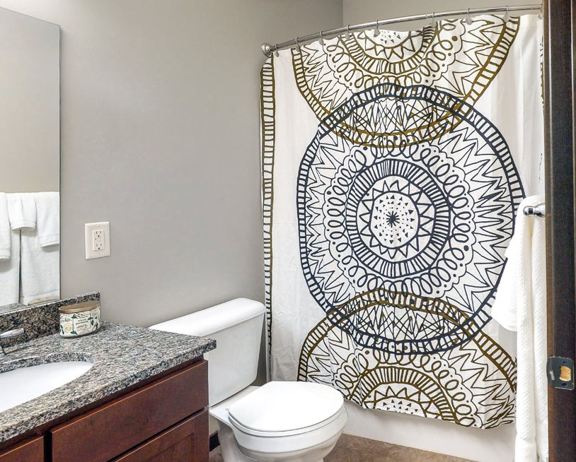 This full bathroom with tub/shower combo is available in the Cedar floor plan at the Villas at Wilderness Ridge