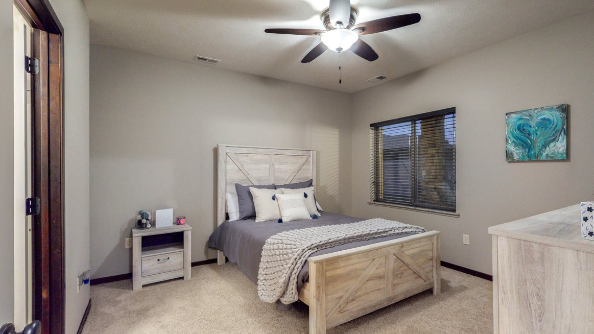 Spacious bedrooms and ample closet spaces are found in the Cedar floor plan