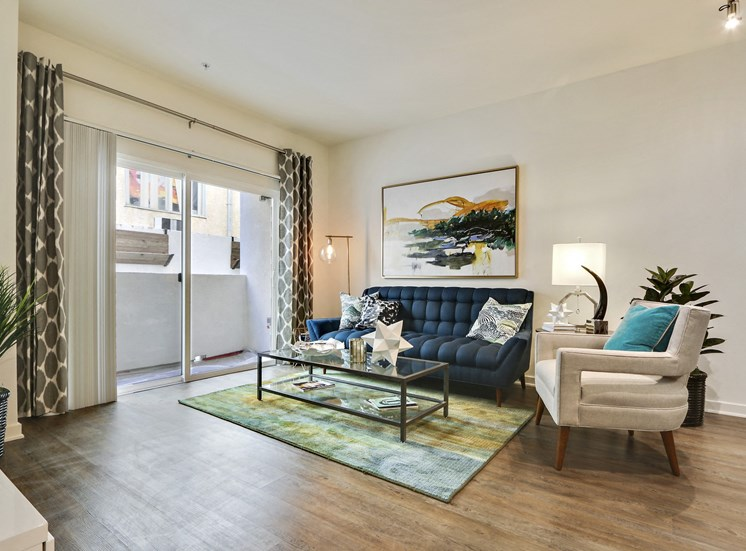 Apartments in Hollywood for Rent - Vues on Gordon Apartments Living Room with Wood Flooring and Sliding Glass Doors