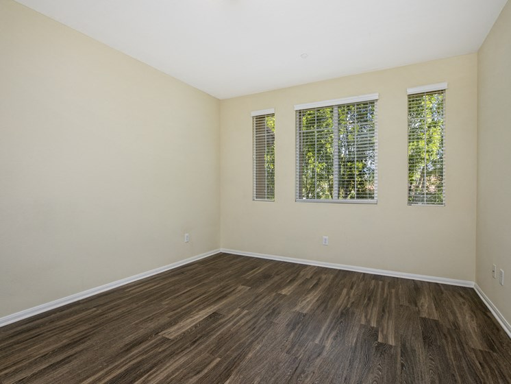 Parkside Villas unfurnished bedroom with wooden floors and window