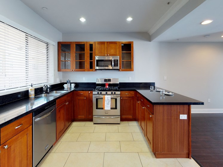 Vista Paradiso two bedroom unit interior kitchen with tile and living room with wooden floors