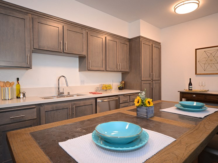 Yolo Apartments kitchen with appliances and activity hub