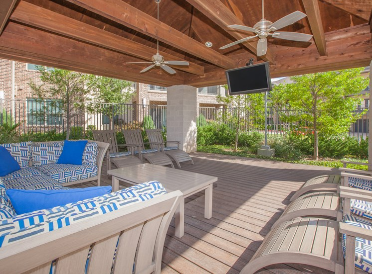 outdoor living area with chairs and tv