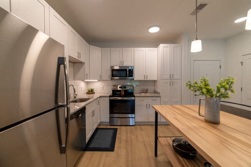 The Approach at Summit Park interior kitchen featuring white cabinets and light colored flooring