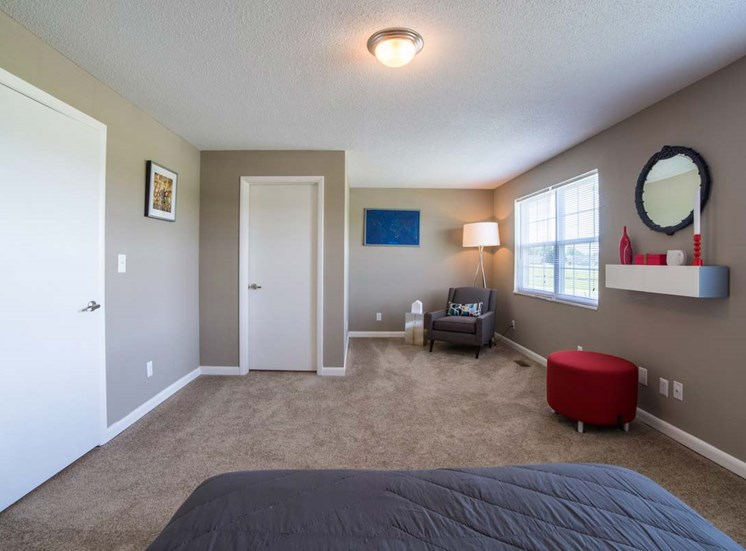 Bedroom With Sofa Chair at Gramercy, Indiana