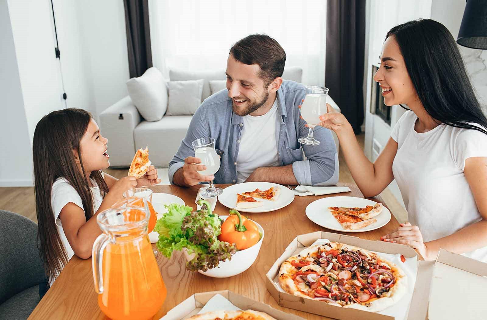 Family at home eating dinner