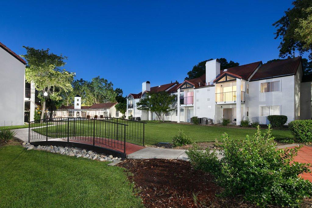 Exterior building with grass and bridge l Laurel Creek in Fairfield CA