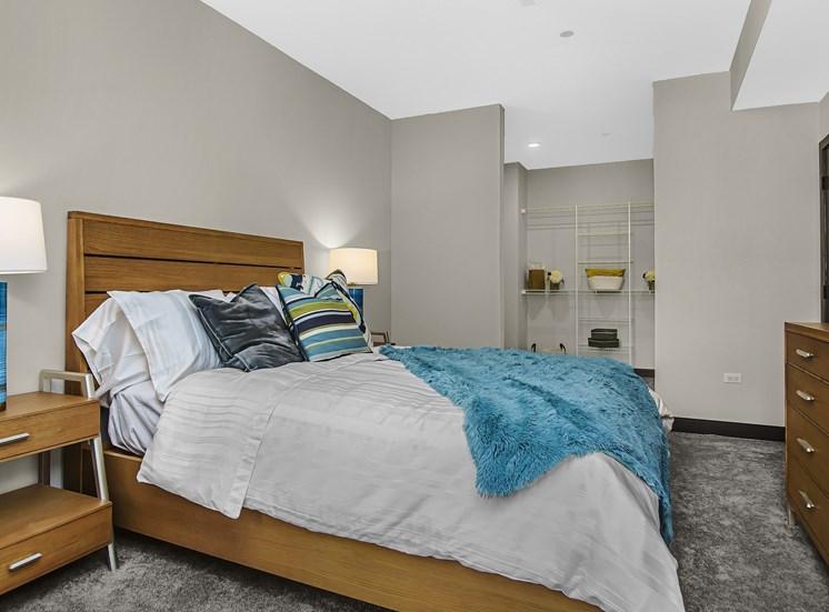 bedroom with adjacent walk in closet