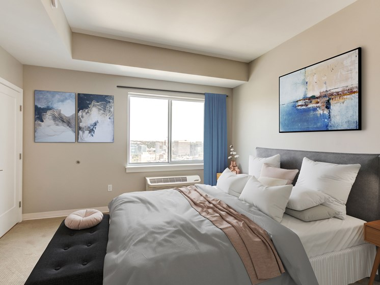 bedroom with large window and modern furnishings