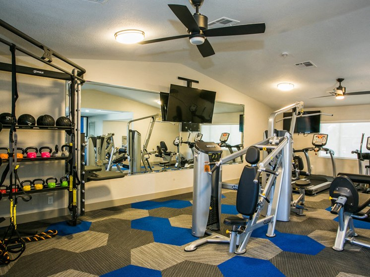 Strength training machines and kettle  Fitness center - Newly renovated