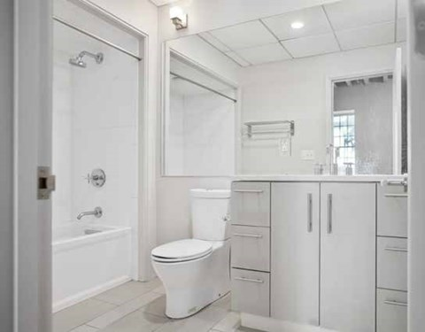 bathroom with white cabinet
