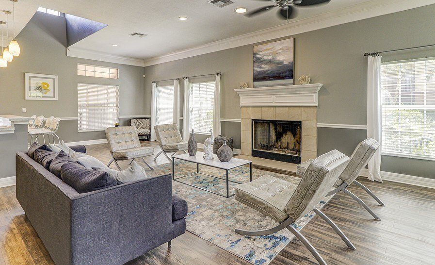 Fireplace Sitting Area In Clubroom at Plantation Gardens Apartments, Pinellas Park, Florida