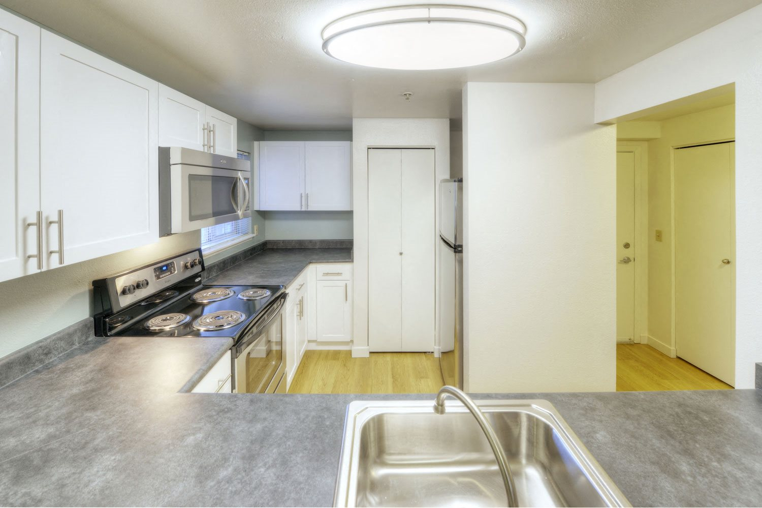 Classic unit kitchen featuring stainless appliances and laminate countertops