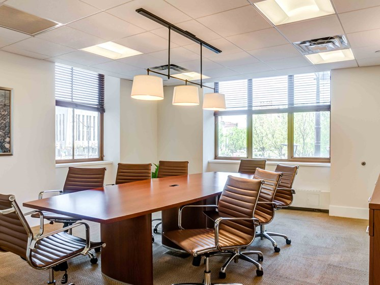 Conference room with table and chairs in light-filled space