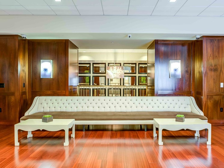 Long white leather sofa against wall in main entry lobby