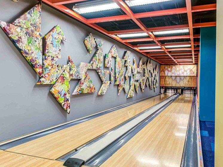 Bowling alley with art installation on wall