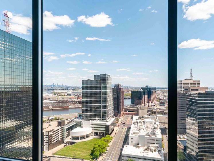 VIew of Newark skyline through apartment window